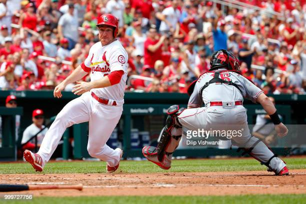 Jedd Gyorko of the St Louis Cardinals scores a run against the Cincinnati Reds in the fourth inning at Busch Stadium on July 15 2018 in St Louis...