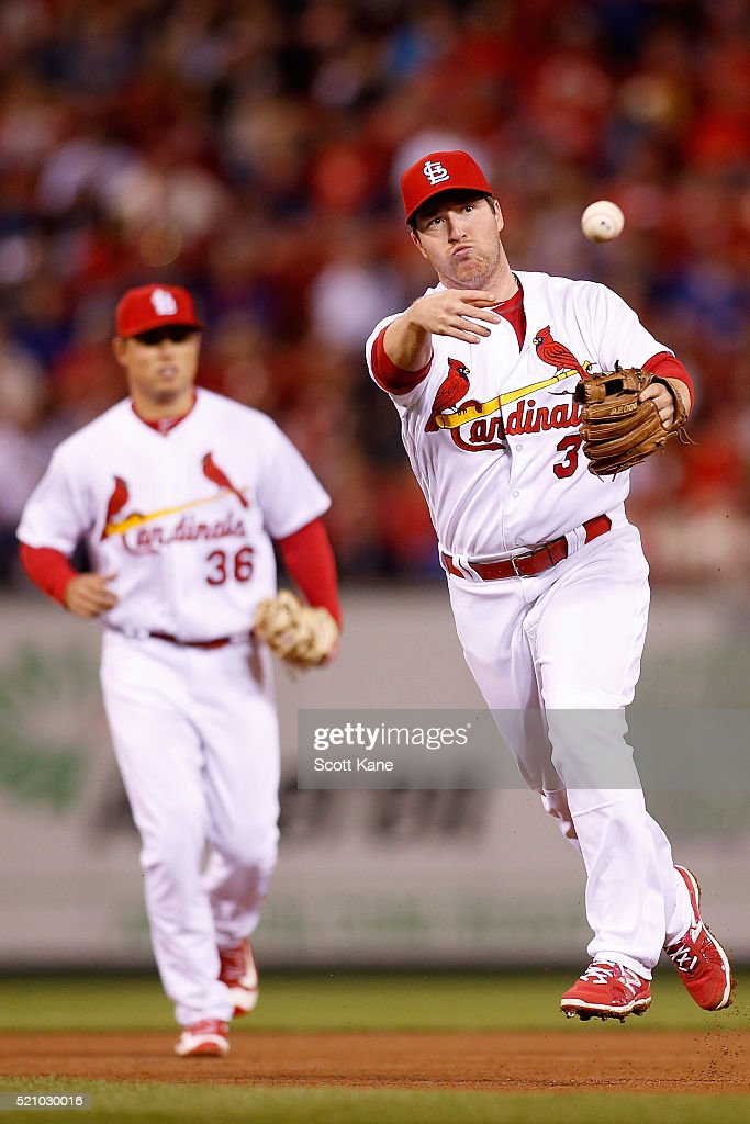 Jedd Gyorko #3 of the St. Louis Cardinals throws to first base for an out during the fifth inning against the Milwaukee Brewers at Busch Stadium on April 13, 2016 in St. Louis, Missouri.