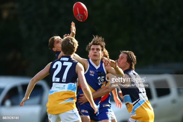 Jedd O'Sullivan of the Ranges competes for the ball surrounded by Pioneers players during the round seven TAC Cup match between the Eastern Ranges...