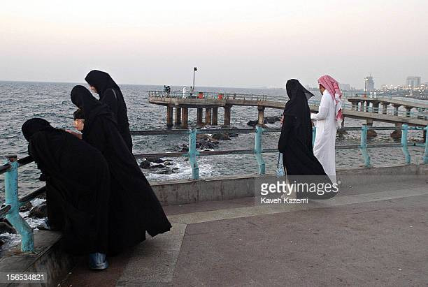 Women in traditional black abaya with their male companions at the beach front in the Corniche district in Jeddah Saudi men are very strict about...