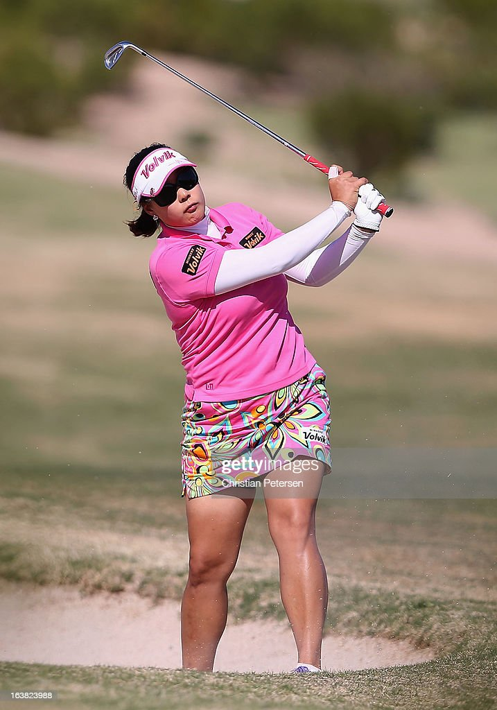 Jee Young Lee of South Korea hits her second shot from the bunker on the 16th hole during the third round of the RR Donnelley LPGA Founders Cup at Wildfire Golf Club on March 16, 2013 in Phoenix, Arizona.