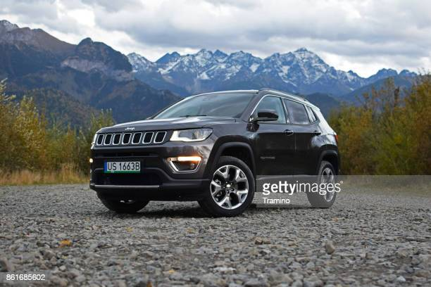 jeep compass on the rocky square - jeep stock pictures, royalty-free photos & images