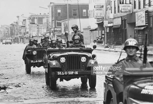 Jeep convoy carrying military police from the National Guard on the streets during the race riots in Newark, New Jersey, July 1967. The Newark riot...