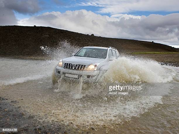 Jeep crossing glacial river, Iceland