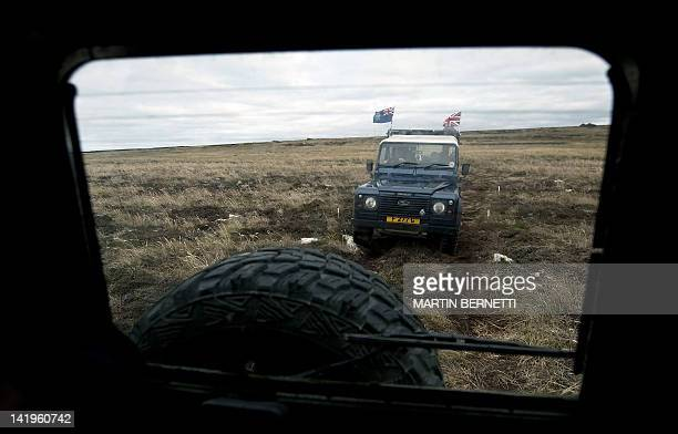 A jeep drives through a field near Port Stanley in the Falkland Islands on March 27 2012 Next April 2 commemorates the 30th anniversary of the war...