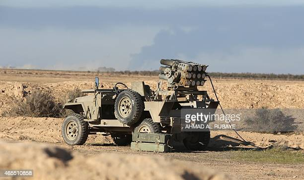 Jeep mounted with a rocket launcher is stationed by Iraqi Shiite fighters, members of Iraq's Popular Mobilisation units backing the government,...