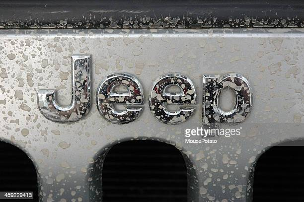 jeep name badge logo on a silver wrangler splash marks - jeep wrangler stock photos and pictures
