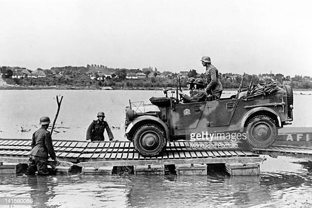 Jeep of a Hungarian army unit crossing the River Bug on the Russian front on an improvised gangway August 1941