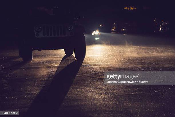 Jeep On Road At Night