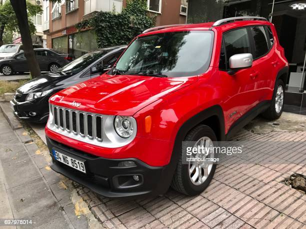 jeep renegade parking in the street - compact car stock photos and pictures