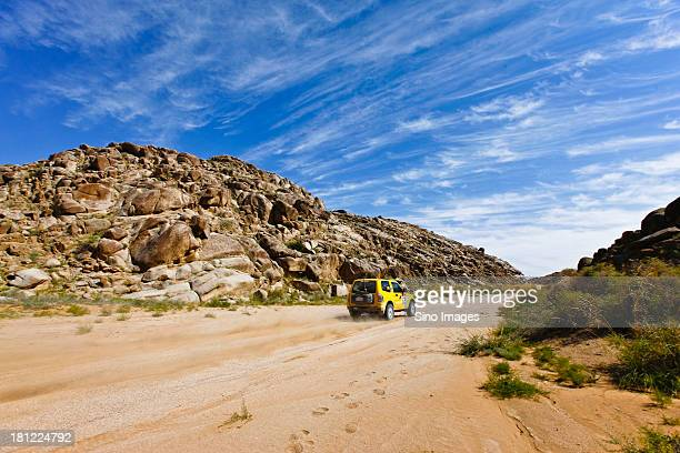 Jeep running in Badain Jaran Desert