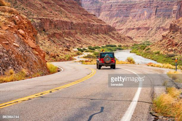 jeep suv on utah route 128 scenic byway near moab utah usa - jeep wrangler stock photos and pictures