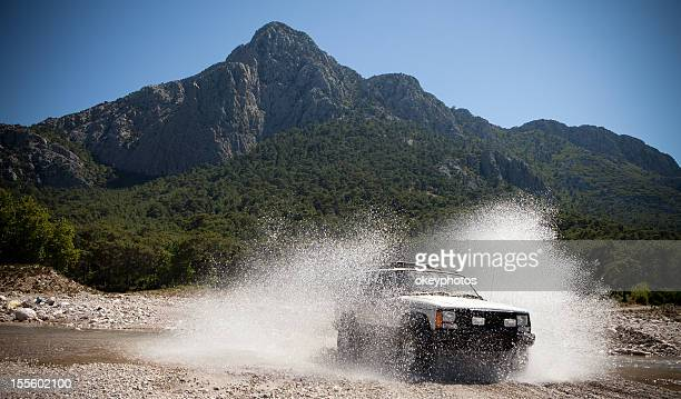 jeep, throwing the water stream passing through