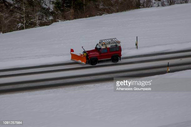 Jeep with a large snow blower travels down an icy and snowy mountain road Viewed from the Bernina Express at the Swiss Alps on January 02 2019 in St...