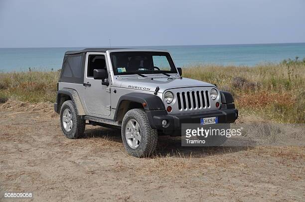 jeep wrangler on the unmade road - jeep wrangler stock photos and pictures