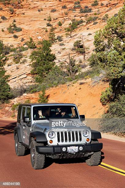 jeep wrangler rubicon driving in zion national park usa - jeep wrangler stock photos and pictures