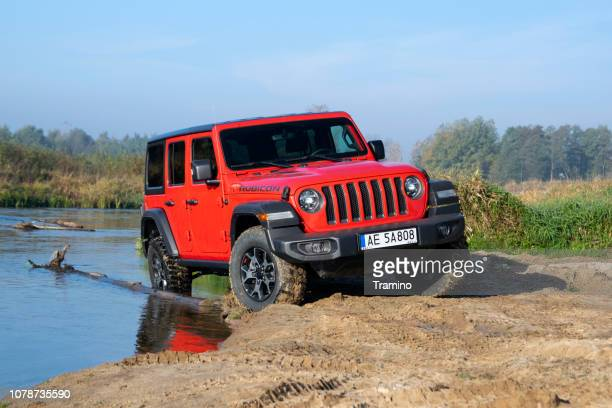 jeep wrangler rubicon on the riverside - jeep wrangler stock photos and pictures