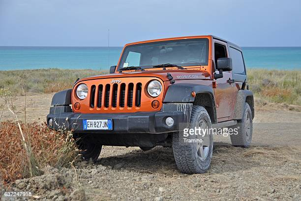 jeep wrangler rubicon on the unmade road - jeep wrangler stock photos and pictures