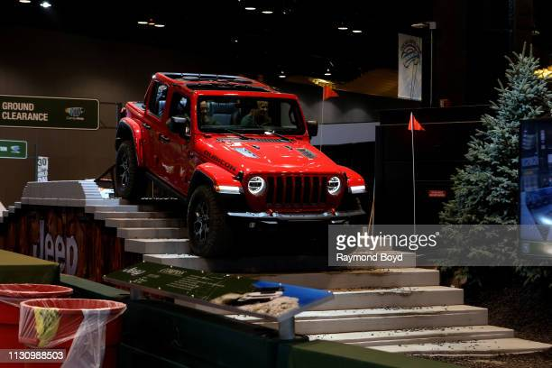 Jeep Wrangler Rubicon performs during the 'Jeep Experience' at the 111th Annual Chicago Auto Show at McCormick Place in Chicago, Illinois on February...