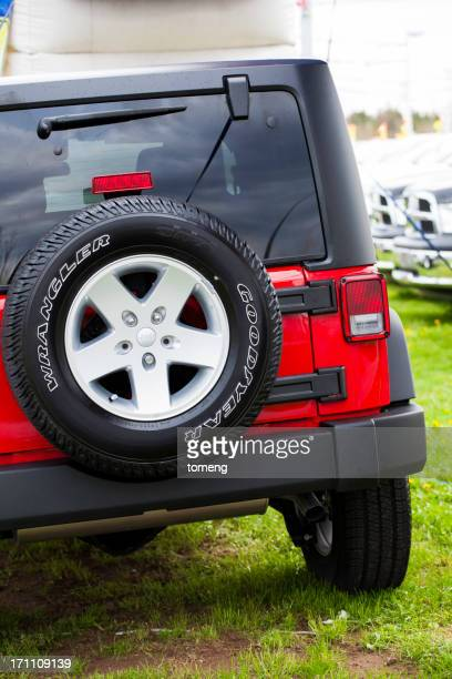 jeep wrangler sport rear view - jeep wrangler stock photos and pictures