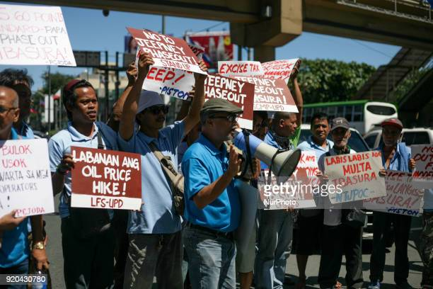 Jeepney drivers belonging to the activist jeepney driver group PISTON hold a protest against the Philippine government's jeepney phaseout program in...
