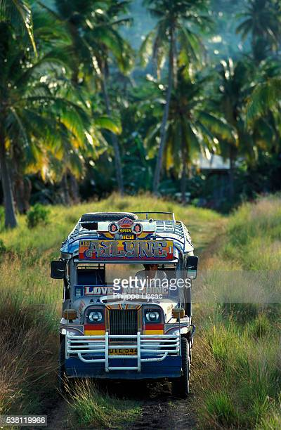jeepney driving down rural road - jeepney stock pictures, royalty-free photos & images