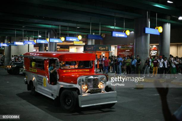 A jeepney filled with passengers leaves a loading bay in Manila Philippines on Thursday February 1 2018 The Jeepney has become a symbol of Filipino...