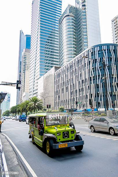 jeepney in makati city, manila, philippines. - makati stock photos and pictures