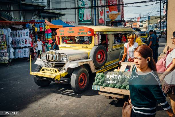 jeepney in manila, philippines - old manila stock pictures, royalty-free photos & images