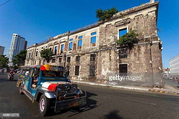 jeepney passes the facade in intramuros, manila, philippines - jeepney stock pictures, royalty-free photos & images