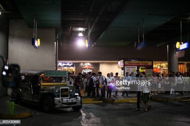 A jeepney stands idle as commuters fall in line at a loading bay in Manila Philippines on Thursday February 1 2018 The Jeepney has become a symbol of...
