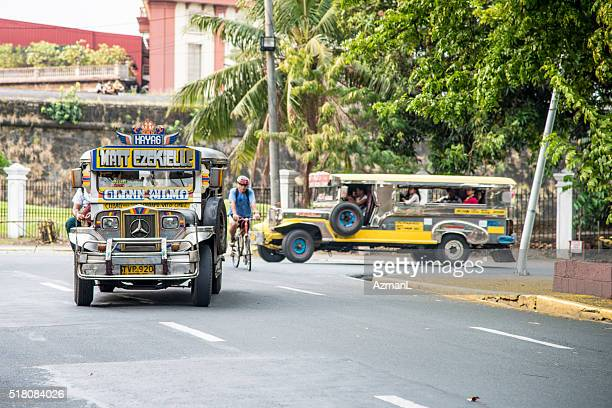 jeepneys in intramuros, manila, philippines. - jeepney stock pictures, royalty-free photos & images