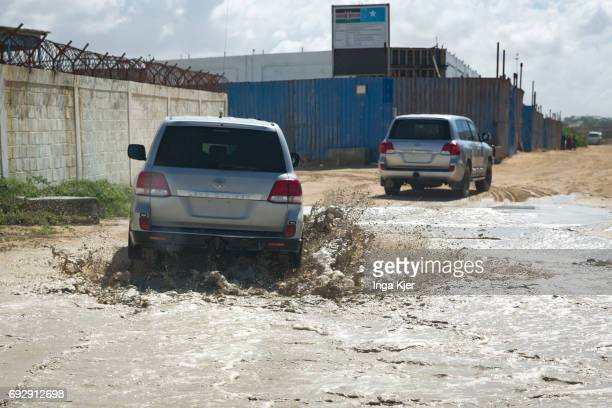 Jeeps with no signs drive through the protected outdoor area of Mogadishu airport on May 01 2017 in Mogadischu Somalia