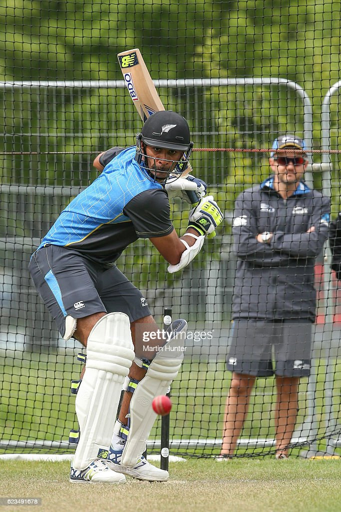 Jeet Raval of New Zealand bats as coach Mike Hesson watches during a New Zealand nets session at Hagley Oval on November 16, 2016 in Christchurch, New Zealand.