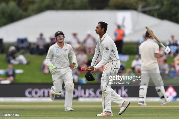 Jeet Raval of New Zealand celebrates taking a catch to dismiss Ben Stokes of England during day four of the Second Test match between New Zealand and...