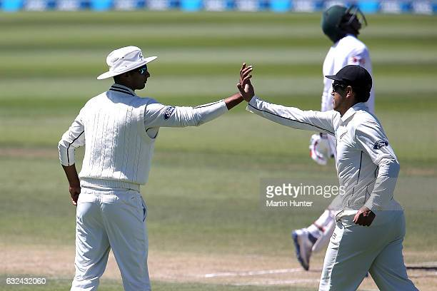 Jeet Raval of New Zealand celebrates with Roass Taylor after the wicket of Soumya Sarkar of Bangladesh during day four of the Second Test match...