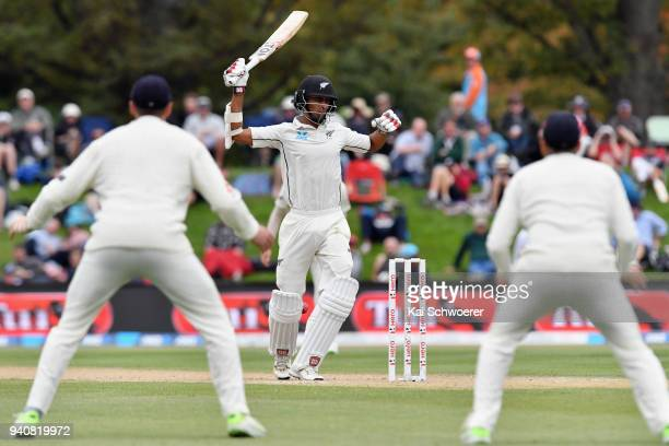 Jeet Raval of New Zealand reacts after being hit by a ball during day four of the Second Test match between New Zealand and England at Hagley Oval on...