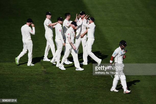 Jeet Raval of New Zealand walks off after being dismissed by James Anderson of England during day one of the First Test match between New Zealand and...