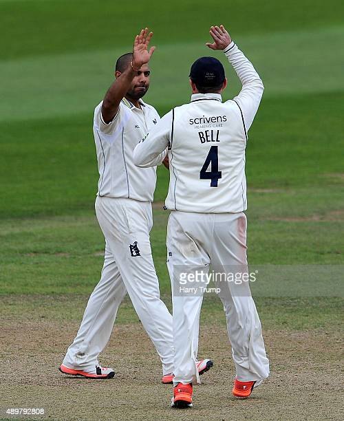 Jeetan Patel and Ian Bell of Warwickshire celebrate the wicket of Peter Trego of Somerset during the LV County Championship match between Somerset...