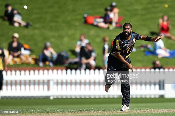Jeetan Patel of the Firebirds bowls during the McDonalds Super Smash T20 match between Wellington Firebirds and Canterbury Kings at Basin Reserve on...