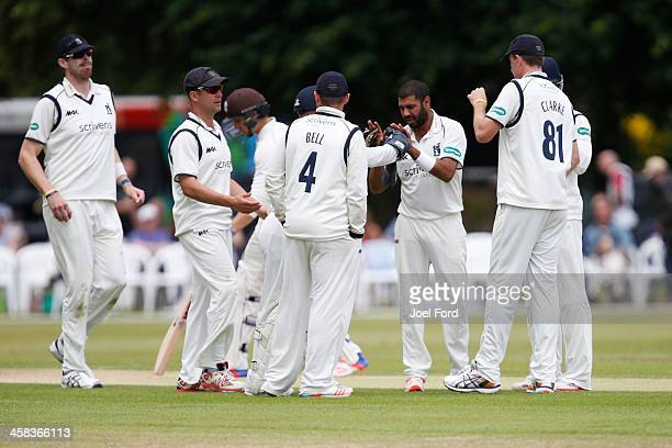 Jeetan Patel of Warwickshire is congratulated by teammates after taking the wicket of Roy Burns of Surrey during the Specsavers County Championship...