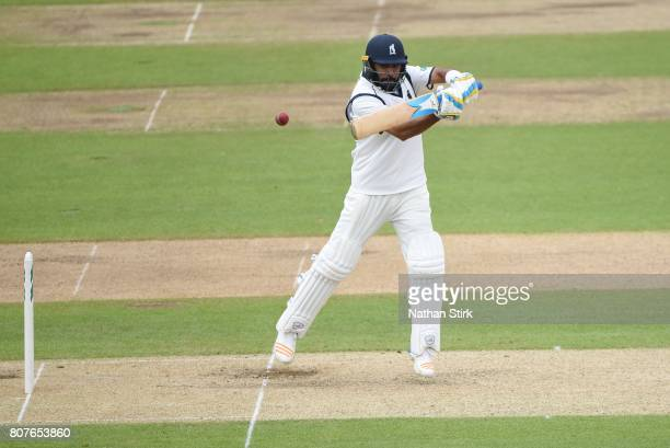 Jeetan Patel of Warwickshire plays the cut shot while batting during the Specsavers County Championship Division One match between Warwickshire and...
