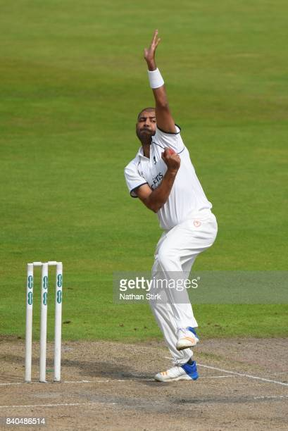 Jeetan Patel of Warwickshire runs into bowl during the County Championship Division One match between Lancashire and Warwickshire at Old Trafford on...