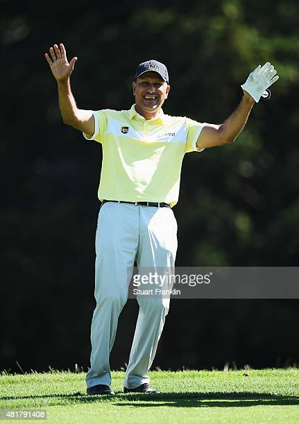 Jeev Milkah Singh of India laughs and waves during the second round of the Omega European Masters at CranssurSierre Golf Club on July 24 2015 in...