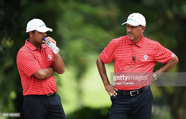 Jeev Milkha Singh captain of team Asia looks on with Anirban Lahiri during thee second day's foursome matches at the EurAsia Cup presented by...