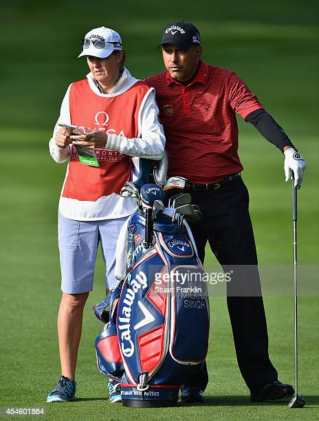 Jeev Milkha Singh of India and caddie Janet Berry discuss a shot during the first round of the Omega European Masters at CranssurSierre Golf Club on...