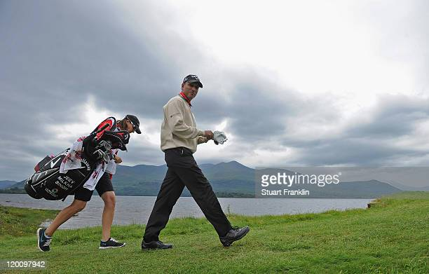 Jeev Milkha Singh of India and caddie Janet Berry walk on the fourth hole during the third round of the Discover Ireland Irish Open at the Killarney...