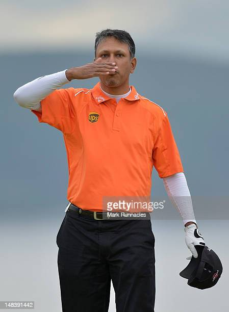 Jeev Milkha Singh of India blows a kiss after holing a putt for victory during a playoff against Francesco Molinari of Italy on the 18th green during...
