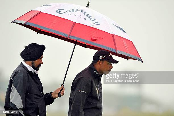 Jeev Milkha Singh of India pictured during a practice round with his coach Amritinder Singh of India at the 141st Open Championship at Royal Lytham...