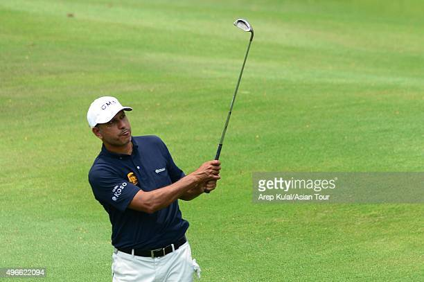 Jeev Milkha Singh of India plays a shot during ProAM tournament ahead of the World Classic Championship at Laguna National Golf Country Club on...